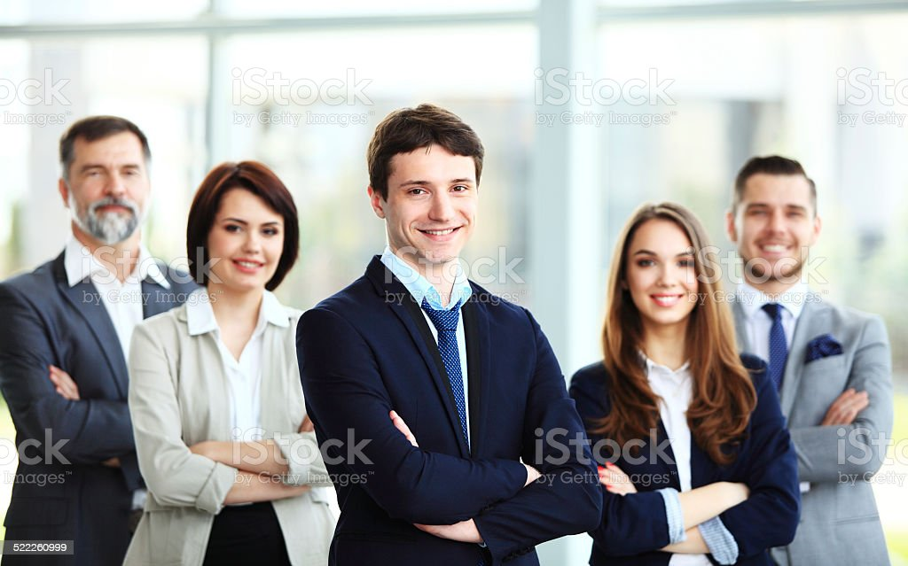 Happy smiling business team in office stock photo
