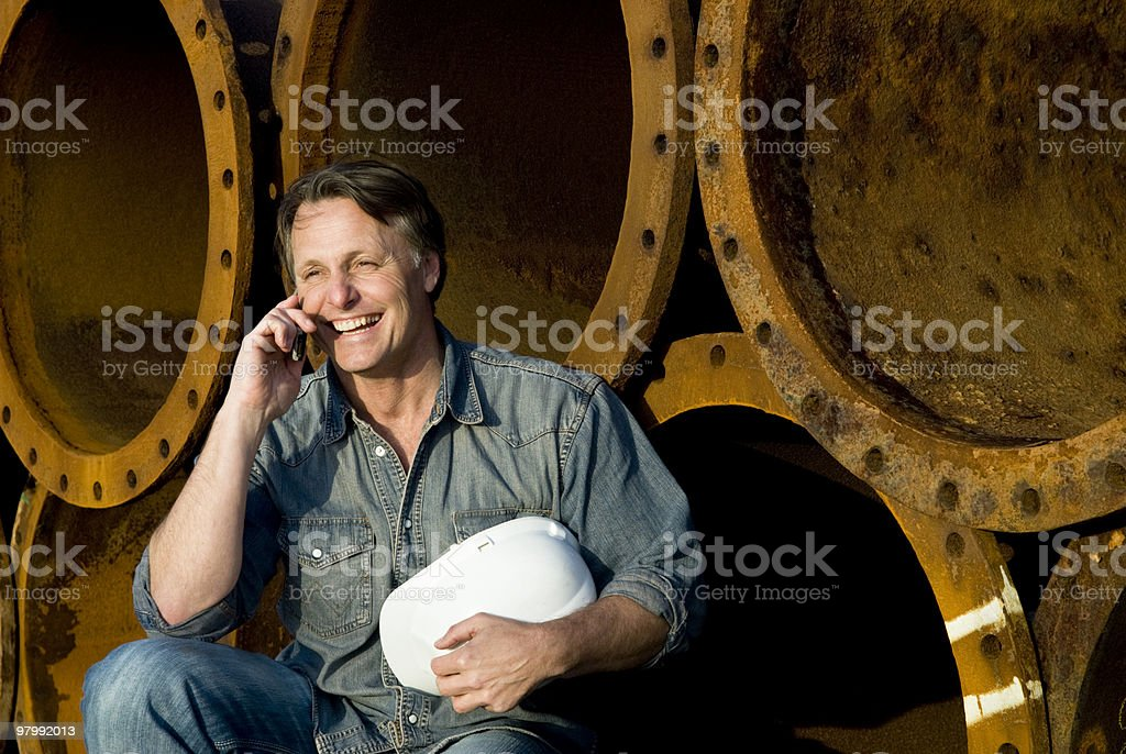 happy smiling construction worker on cellphone. royalty-free stock photo
