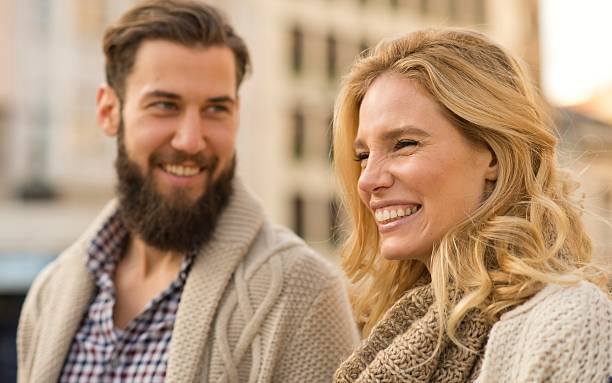 Happy smiling couple walking around the city. stock photo