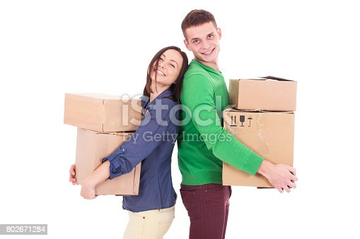istock Happy smiling delivery man and woman carrying boxes isolated on white background 802671284