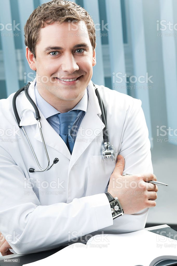 Happy smiling doctor with pen at office royalty-free stock photo