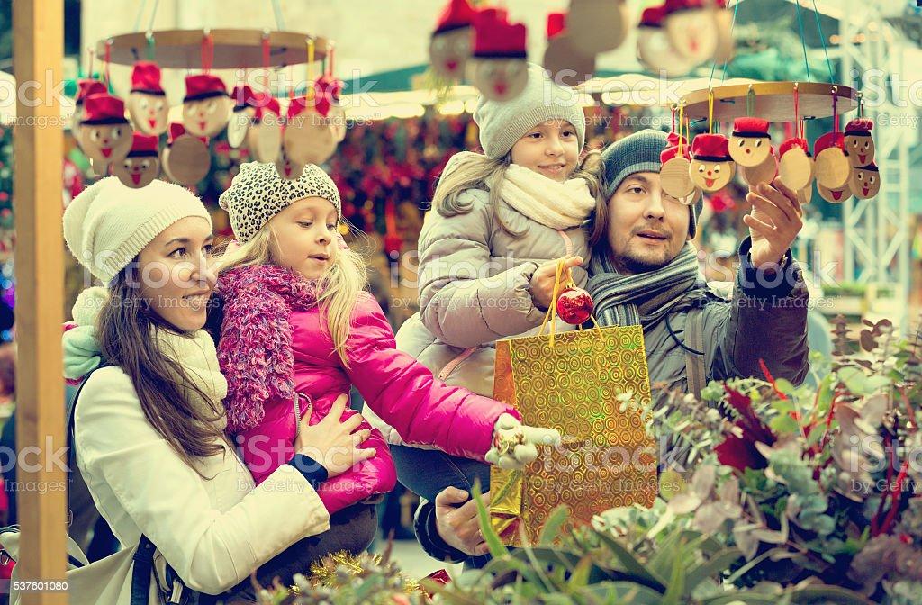 Happy smiling family of four buying Caga Tio stock photo
