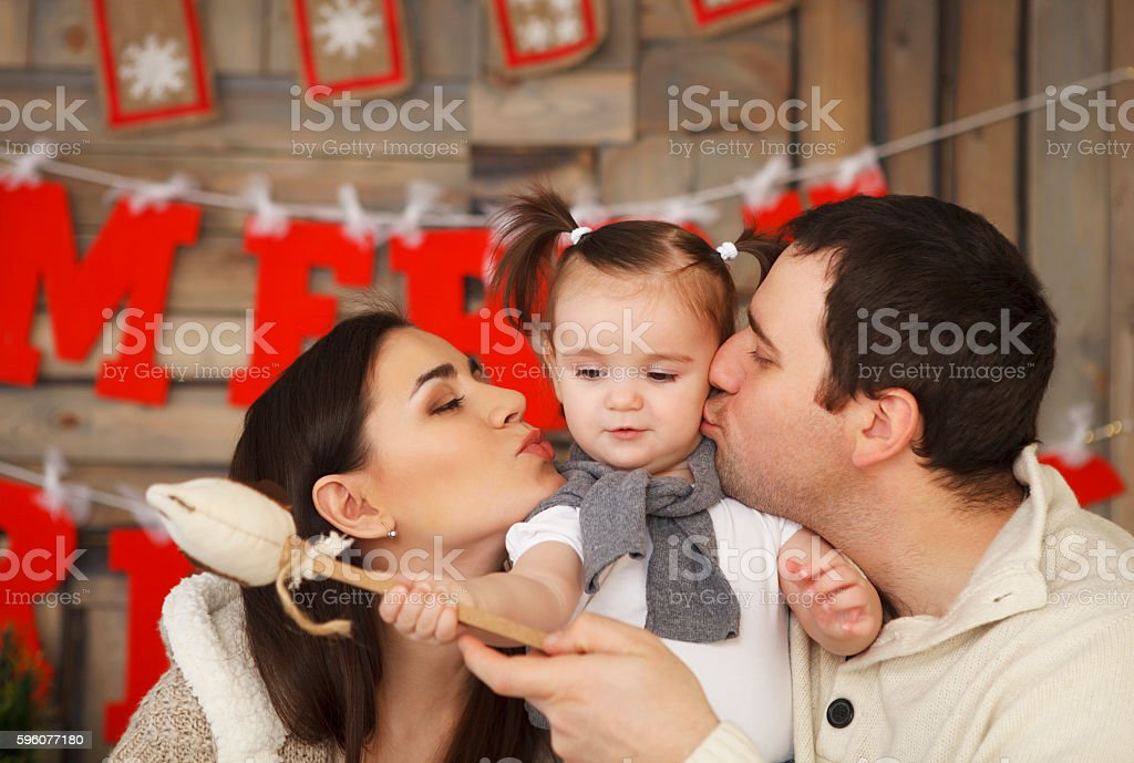 Happy smiling family with one year daughter royalty-free stock photo