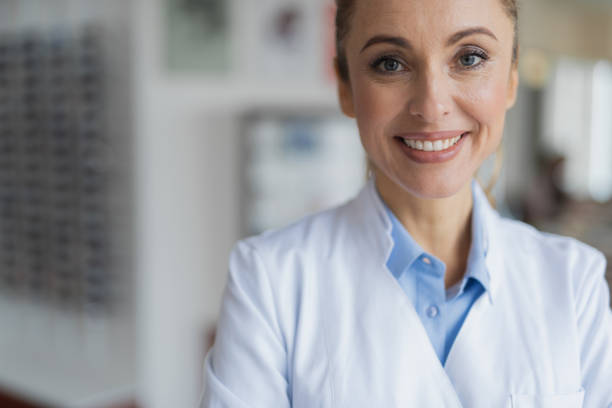 Happy smiling female doctor looking at you stock photo