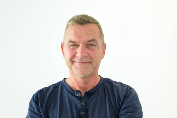 Happy smiling friendly middle-aged man stock photo