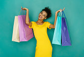 istock Happy smiling girl with shopping bags 882890682