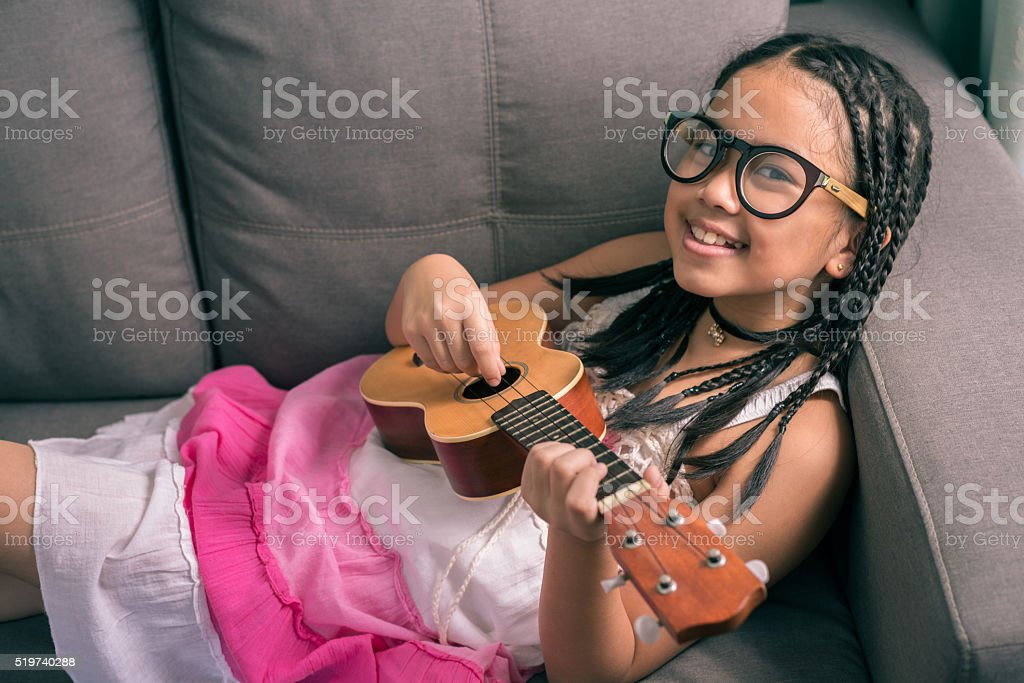 Happy smiling girl,wearing glasses,dreadlocks hair style ,learni stock photo