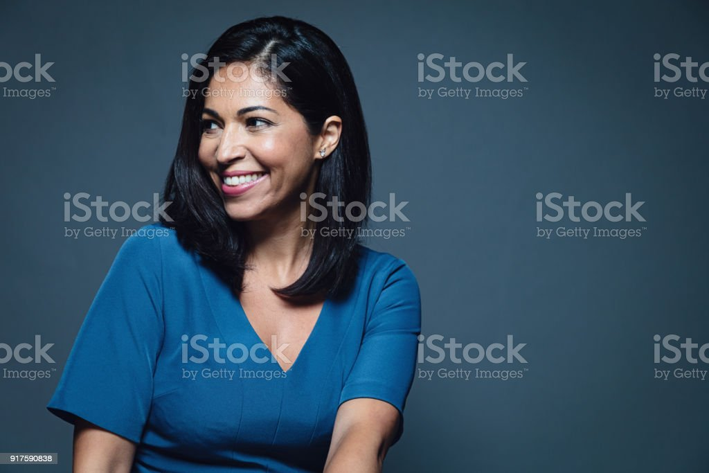 Happy smiling hispanic businesswoman stock photo
