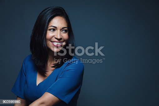istock Happy smiling hispanic woman looking away 902595990