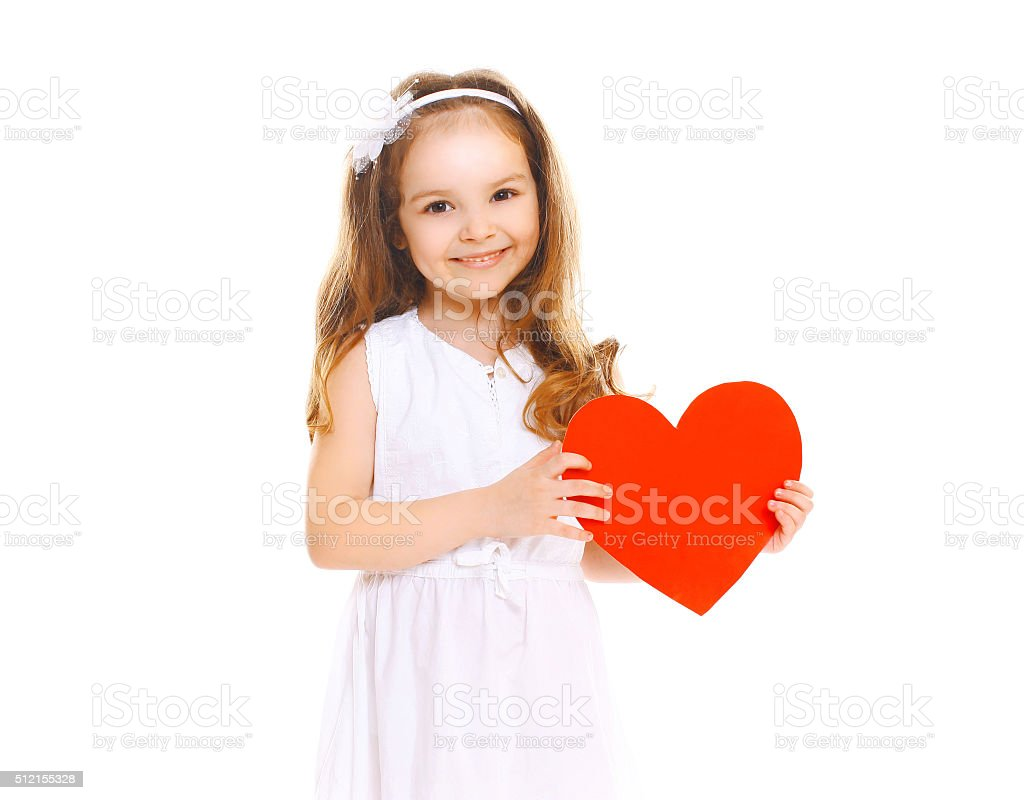Happy smiling little girl child with big red paper heart stock photo