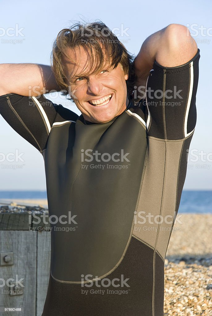 happy smiling man in wetsuit royalty-free stock photo