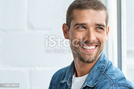 istock Happy smiling man looking away 1158245623