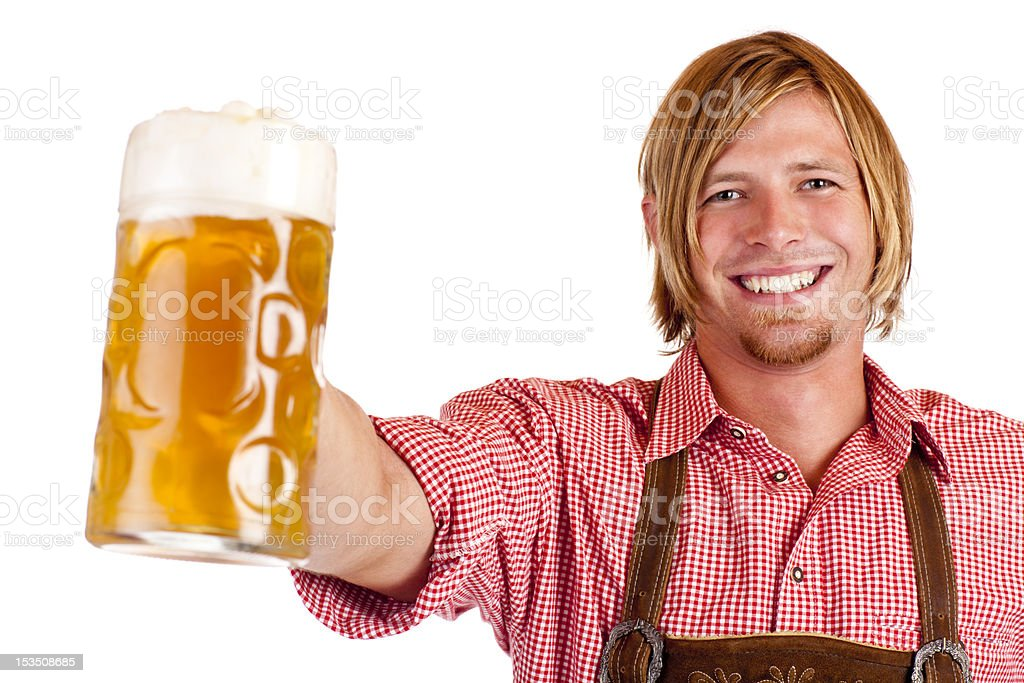 Happy smiling man with leather trousers holds oktoberfest beer stein stock photo