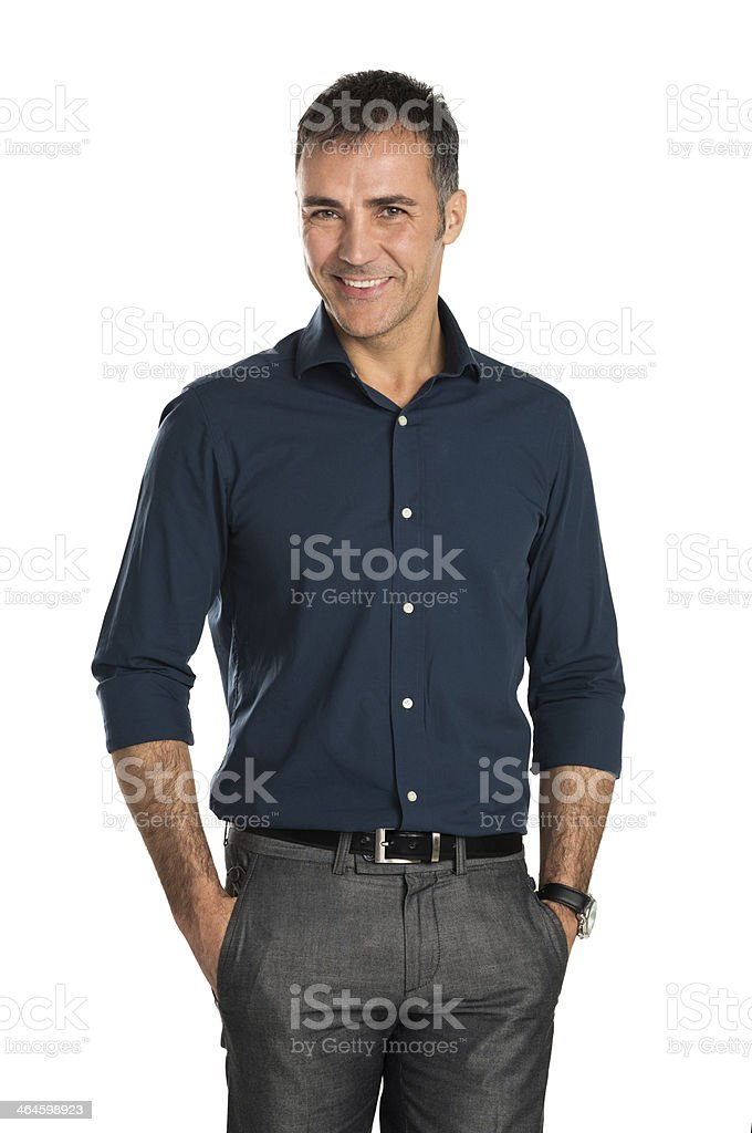 Happy smiling middle age businessman with hands in pockets stock photo