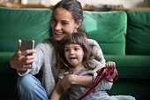 istock Happy smiling mother taking selfie with daughter 1063760200