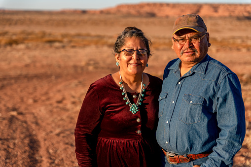 A Happy, Smiling Native American Husband And Wife Near Their Home In Monument Valley, Utah