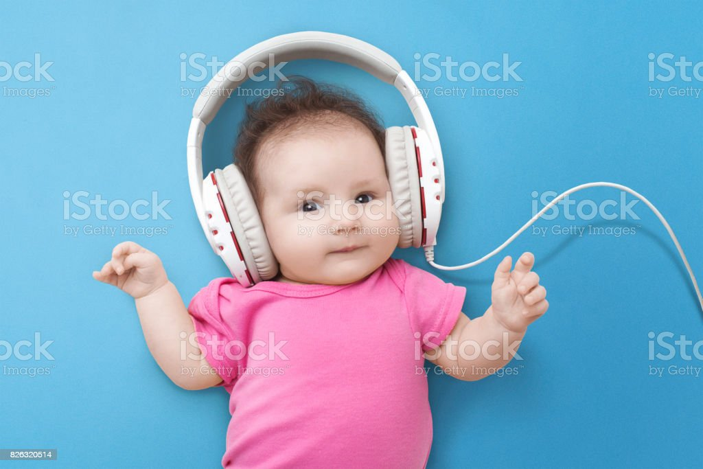 Happy Smiling Newborn Baby Listens To Music Royalty Free Stock Photo