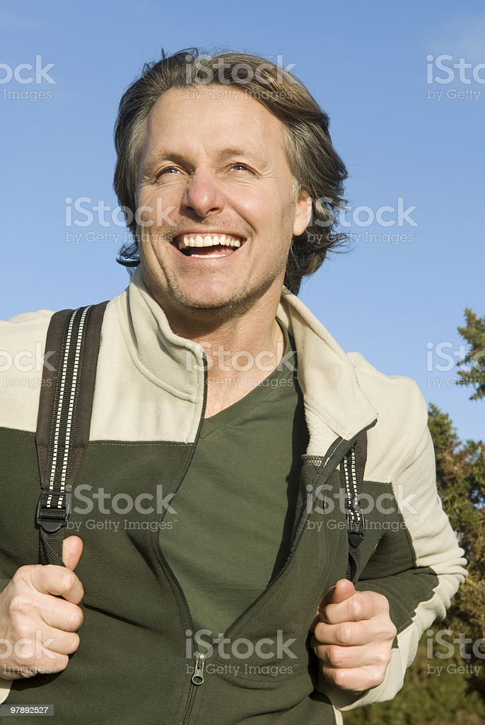 happy smiling outdoor man carrying rucksack royalty-free stock photo