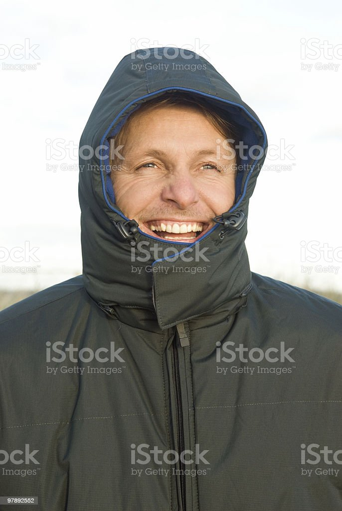 happy smiling outdoor man wearing winter coat royalty-free stock photo