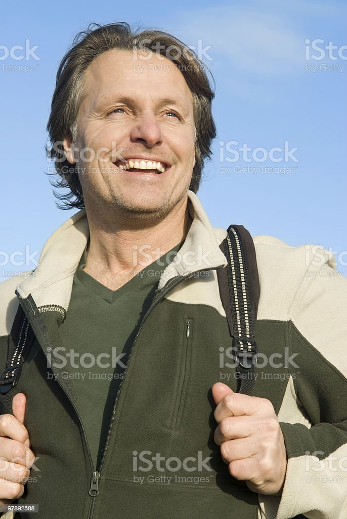 happy smiling outdoor man with rucksack royalty-free stock photo