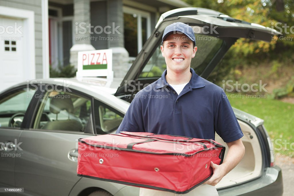 Happy Smiling Pizza Delivery Man with Package Hz stock photo