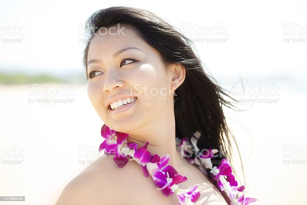 Happy Smiling Portrait of a Hawaiian Girl on the Beach royalty-free stock photo