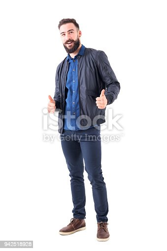 931173966istockphoto Happy smiling relaxed bearded guy showing thumbs up gesture and looking at camera. 942518928
