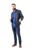 istock Happy smiling relaxed bearded guy showing thumbs up gesture and looking at camera. 942518928