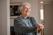 istock Happy smiling senior woman relaxing at home 1296176645