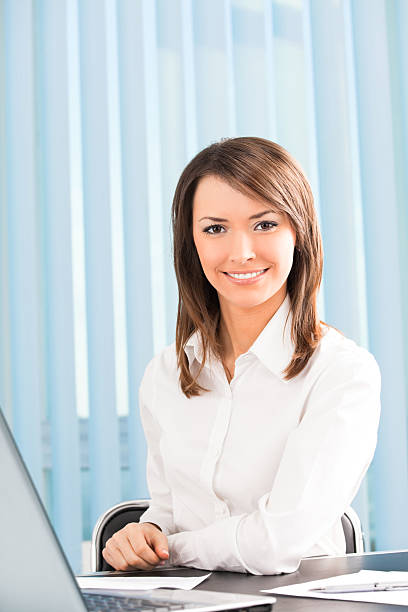 Happy smiling successful businesswoman at office stock photo
