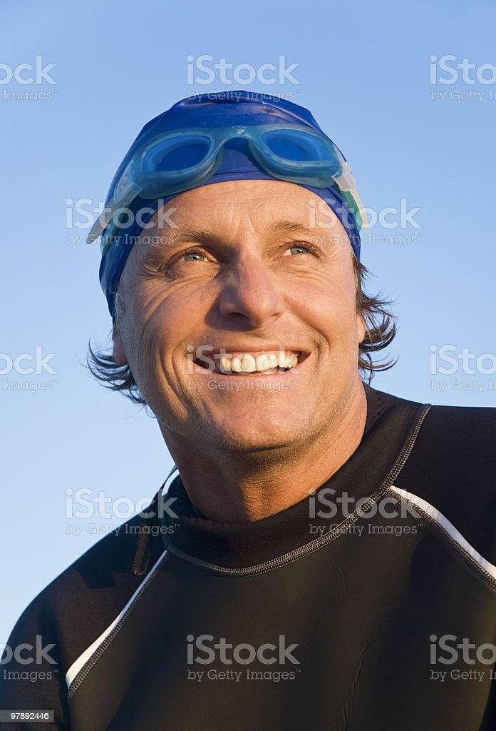 Happy smiling swimmer in wetsuit. royalty-free stock photo