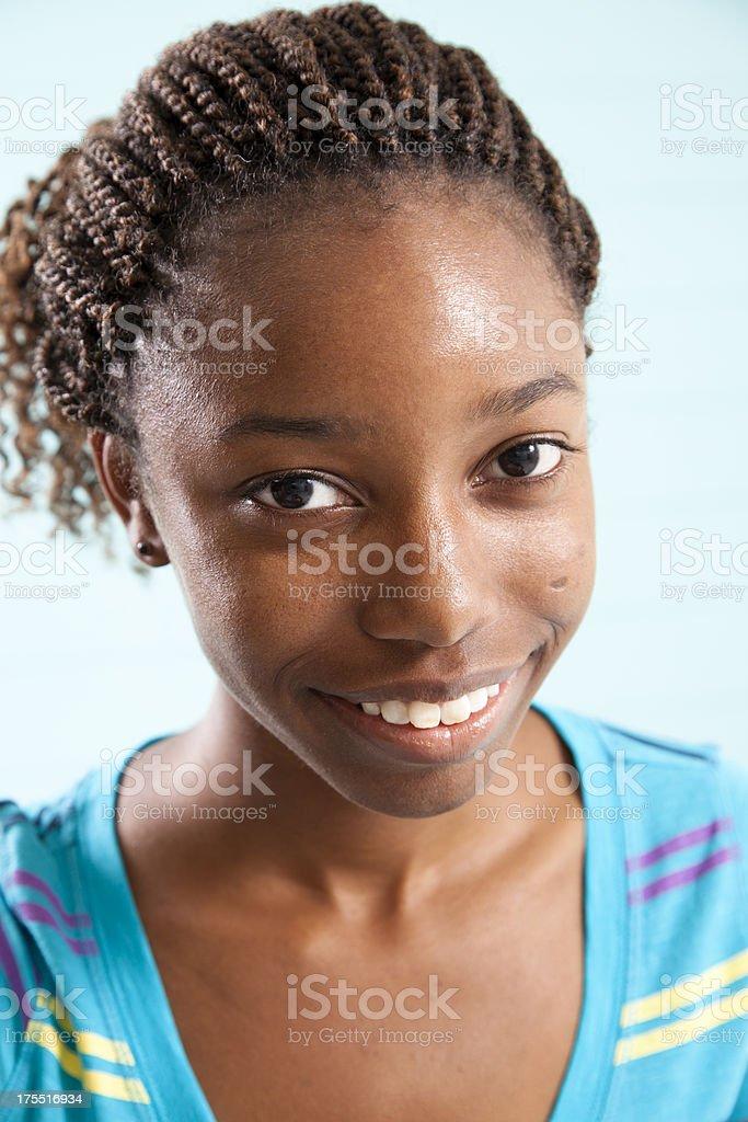 Happy smiling teenage girl wearing braids royalty-free stock photo