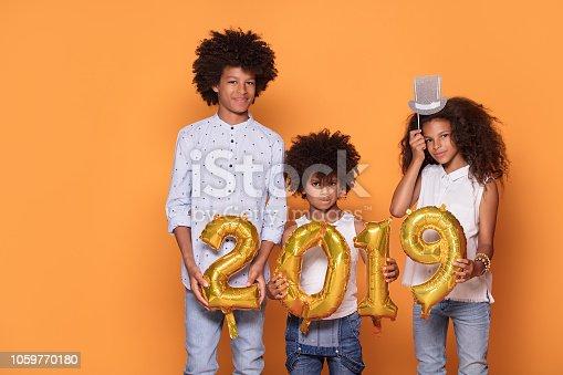 istock Happy smiling three afro children. 1059770180