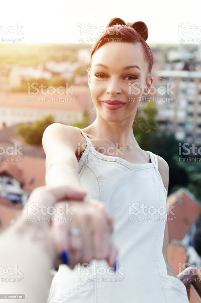 happy smiling woman above the city stock photo
