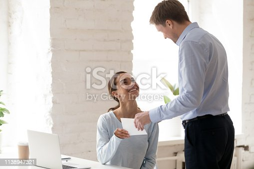 918365170 istock photo Happy smiling woman get promotion notification from manager 1138947321