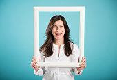 happy smiling woman posing with a picture frame