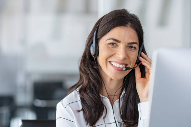 Happy smiling woman working in call center stock photo