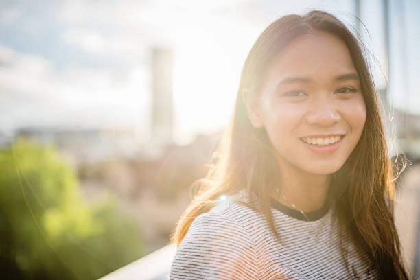 Happy smiling young asian woman looking over stock photo