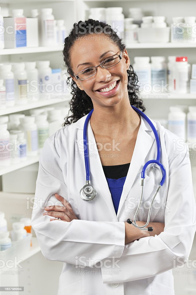 Happy Smiling Young Black Woman, Medical Professional in Hospital Pharmacy royalty-free stock photo