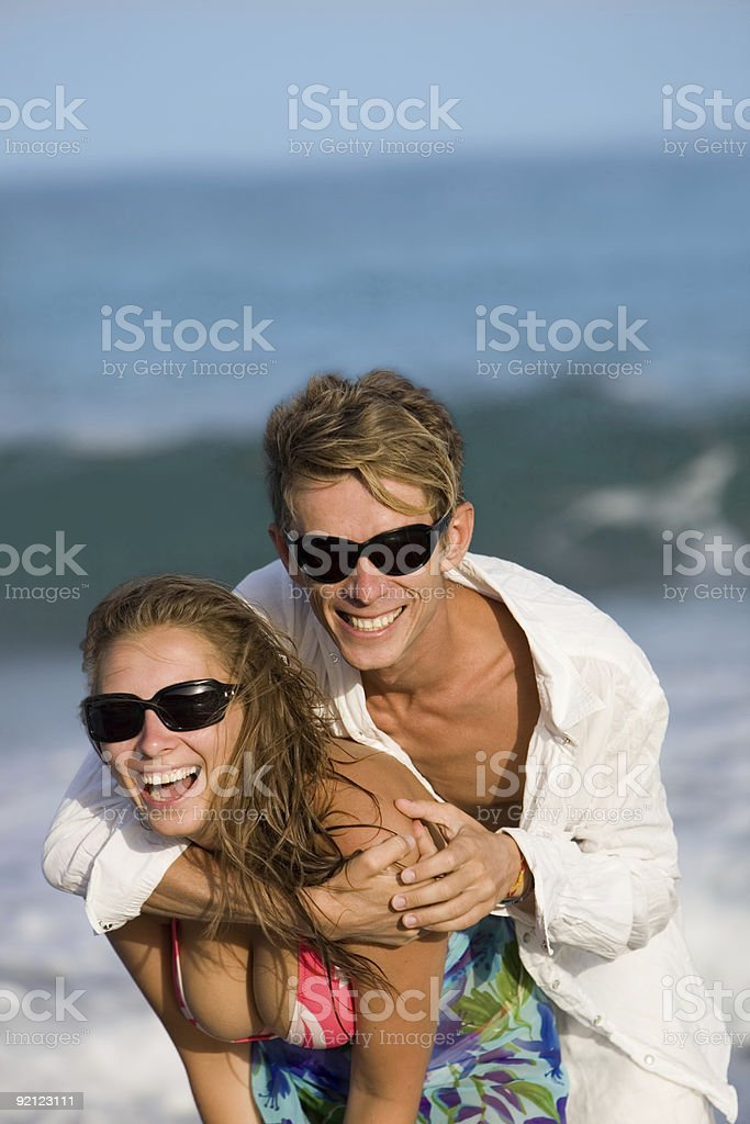 happy smiling young couple  on the beach royalty-free stock photo