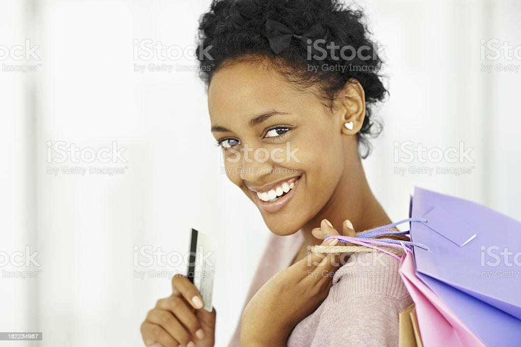 Happy smiling young lady with credit card and shopping bags royalty-free stock photo