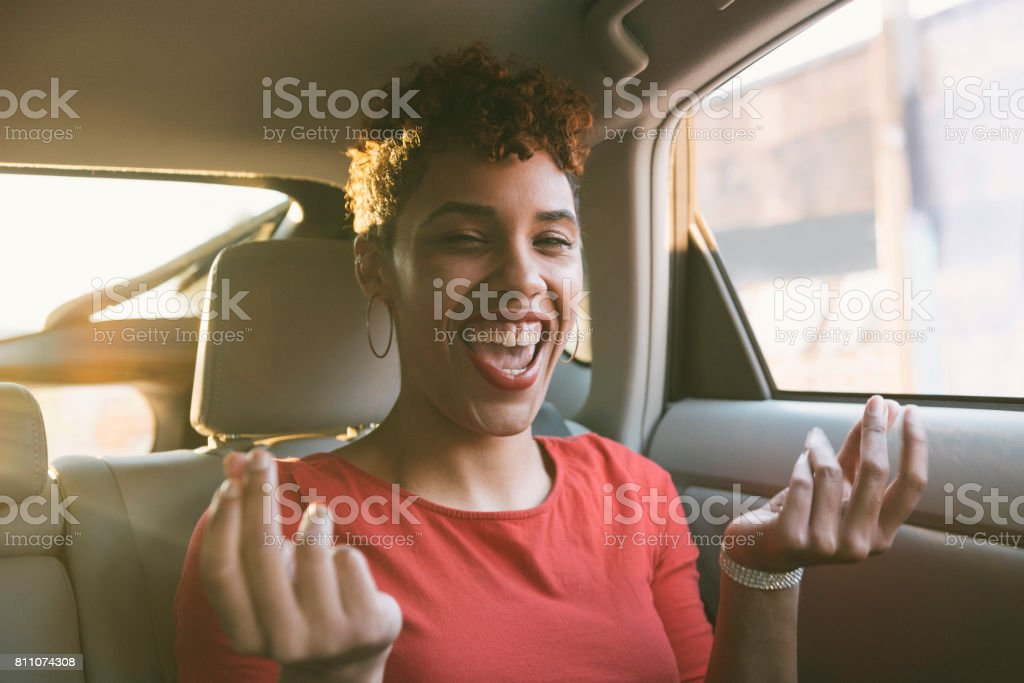 Happy Smiling Young Millennial Mixed Black Woman Singing in Car stock photo