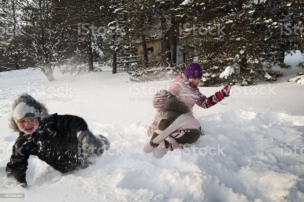 Happy snow fight between young kids. royalty-free stock photo