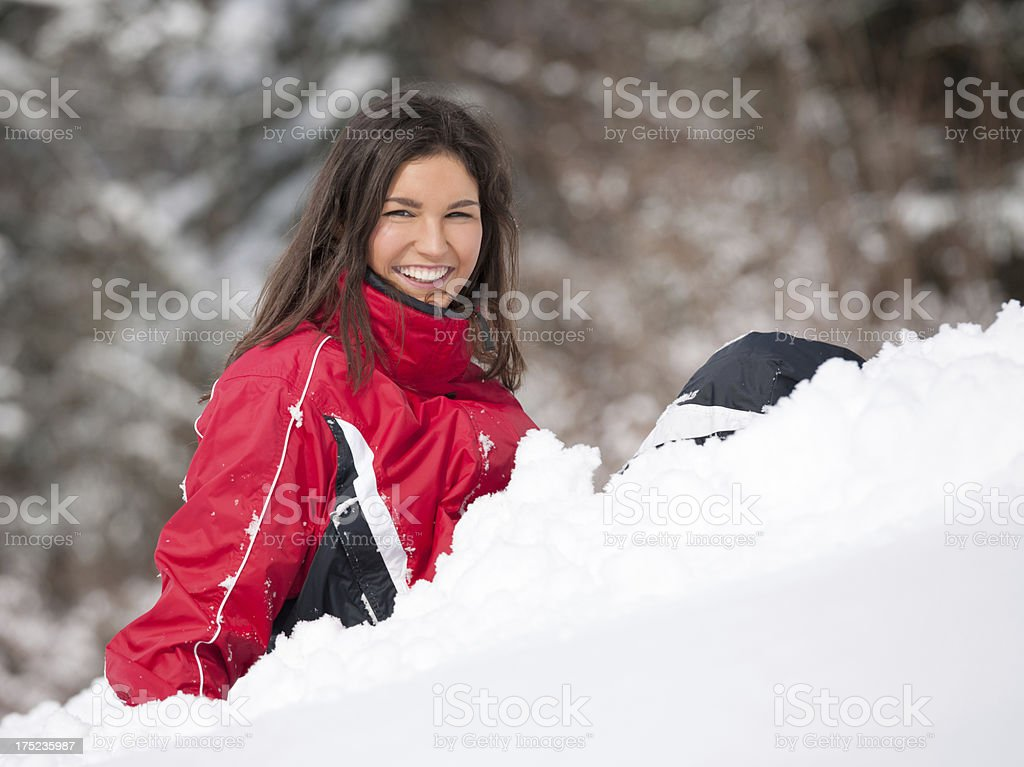 Happy Snowboarder Girl sitting in the Snow, Copy Space royalty-free stock photo