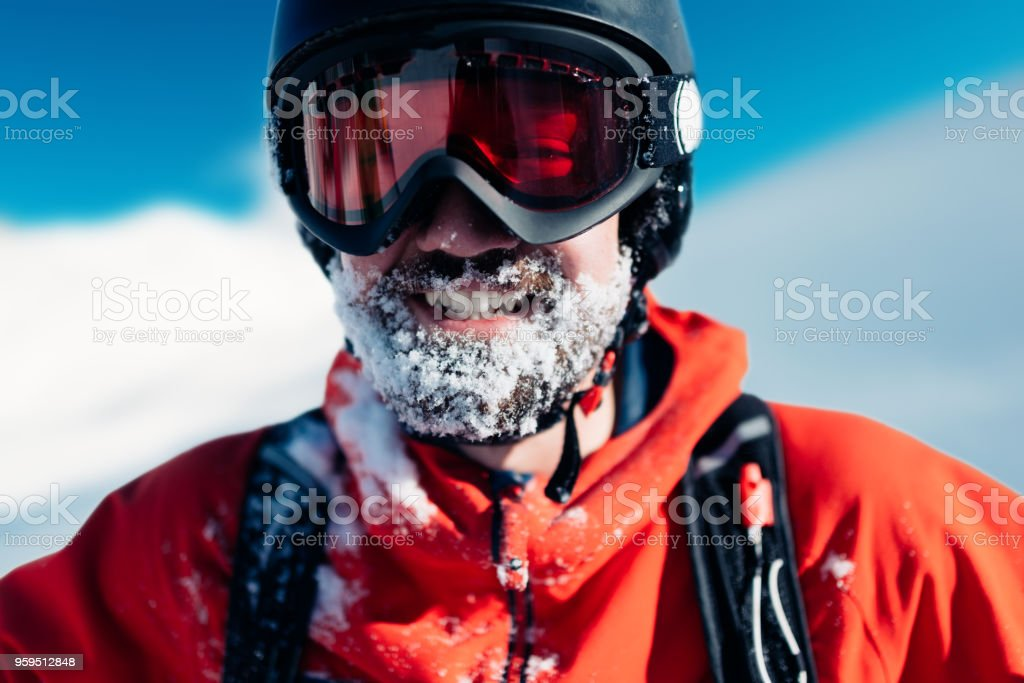 happy snowboarder is standing in the red suit stock photo