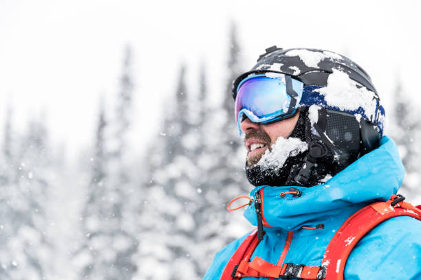 Happy Snowboarder Wearing Helmet and Goggles at The Ski Mountain Happy Snowboarder Wearing Helmet and Goggles at The Ski Mountain ski goggles stock pictures, royalty-free photos & images