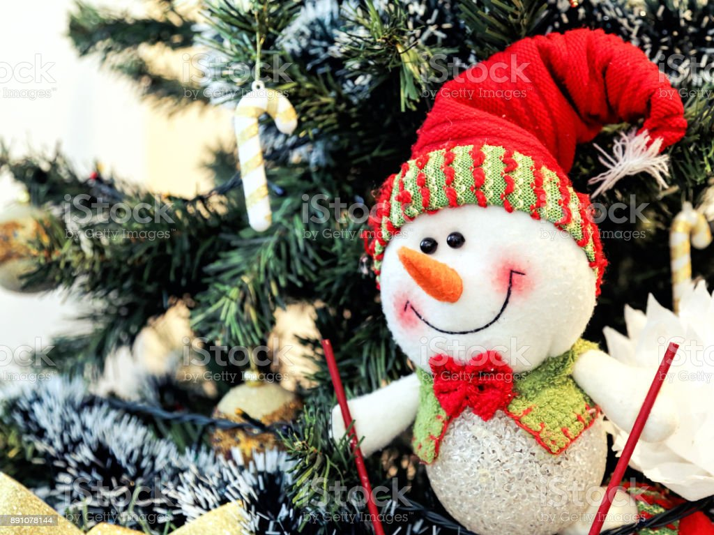 Happy snowman and Christmas tree background stock photo