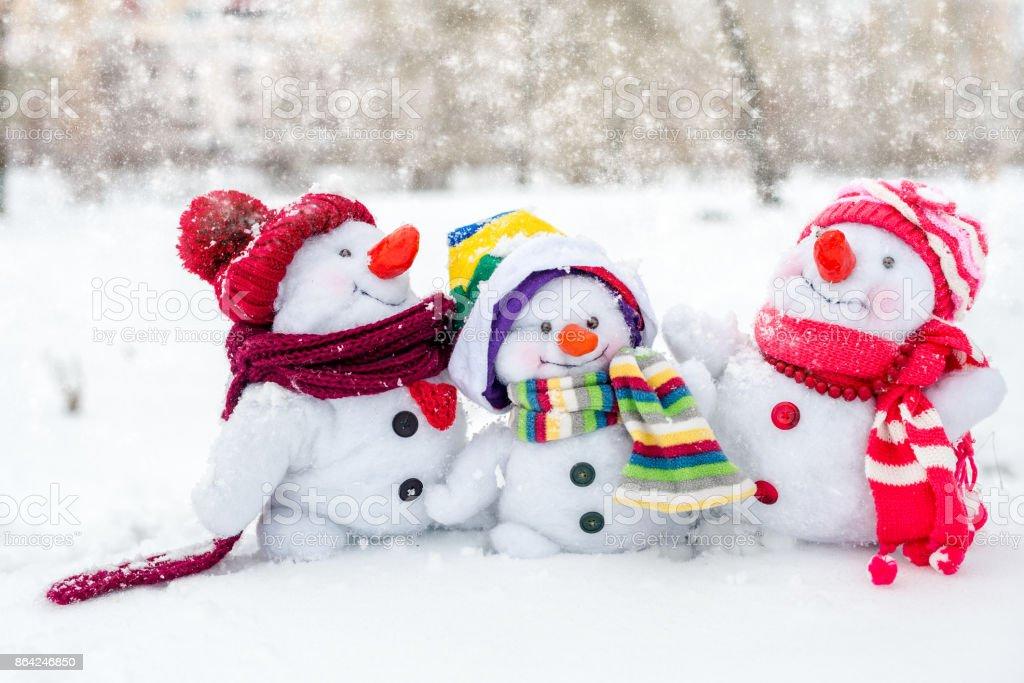 Happy snowman family royalty-free stock photo