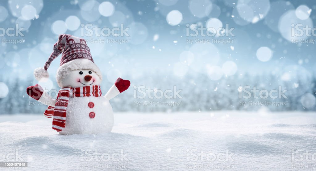 Happy snowman in winter secenery royalty-free stock photo