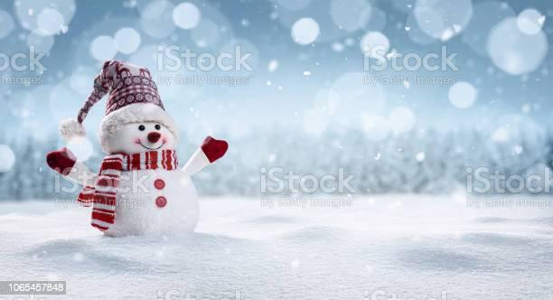 Happy snowman in winter secenery picture id1065457848?b=1&k=6&m=1065457848&s=612x612&h=rx i4obsmsrflwcb 9q tar8wiagw6npxlh9pjatova=